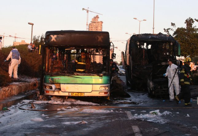 Israeli security officials investigate the scene of a bus explosion in Jerusalem, Israel, on April 18. 2016. An Israeli police spokesman confirmed the explosion was a terror attack caused by a bomb. At least 20 people were wounded, two of them seriously. Hamas and Palestinian groups have praised the terror attack. Photo by UPI