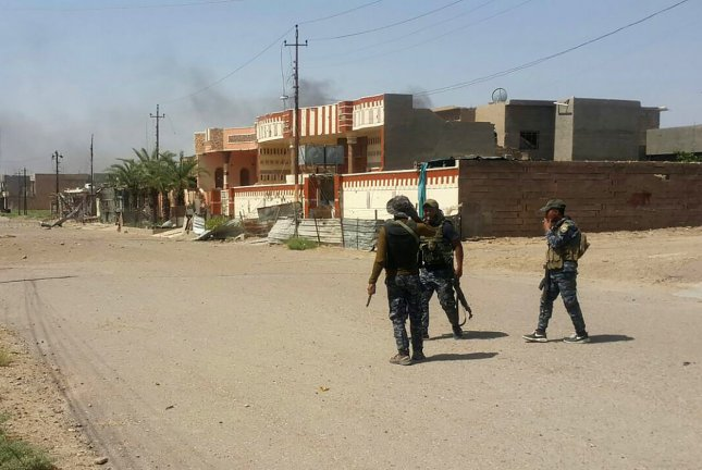 In this image, Iraqi soldiers during clash with Islamic State militants at Shuhadaa neighborhood in Fallujah, Iraq, June 7. The city of Fallujah was retaken by Iraqi security forces earlier this year -- aided by the U.S.-led anti-Islamic State coalition. On Thursday, Iraqi security force took control of the Saladin Governorate's Sharqat district away from the Islamic State, which cut off a supply route to IS-held Mosul. File Photo by Abbas Mohammed/UPI