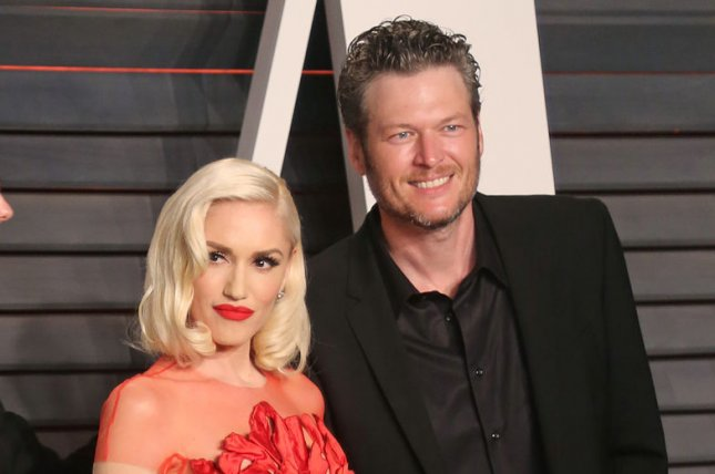 Gwen Stefani (L) and Blake Shelton at the Vanity Fair Oscar party on February 28, 2016. File Photo by David Silpa/UPI