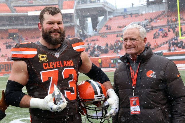 Former Cleveland Browns left tackle Joe Thomas (L) stands with team owner Jimmy Haslam after being named the 2016 Walter Payton Man of the Year on December 11, 2016 at FirstEnergy Stadium in Cleveland. Photo by Aaron Josefczyk/UPI