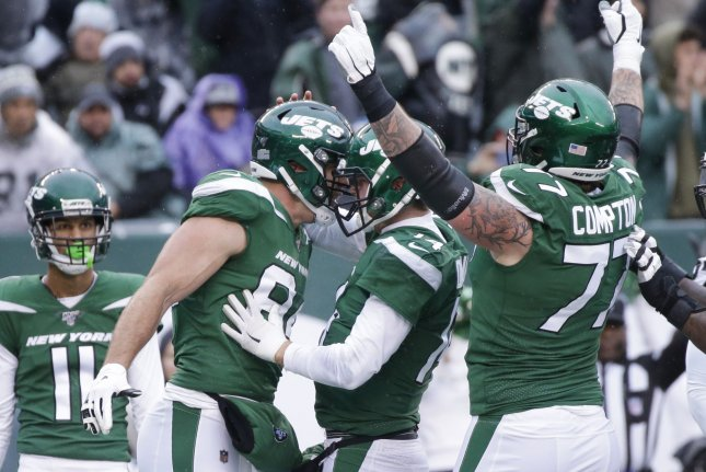 New York Jets quarterback Sam Darnold (C) celebrates with teammates after he dives into the end zone for a rushing touchdown in the first half against the Oakland Raiders on Sunday at MetLife Stadium in East Rutherford, New Jersey. Photo by John Angelillo/UPI