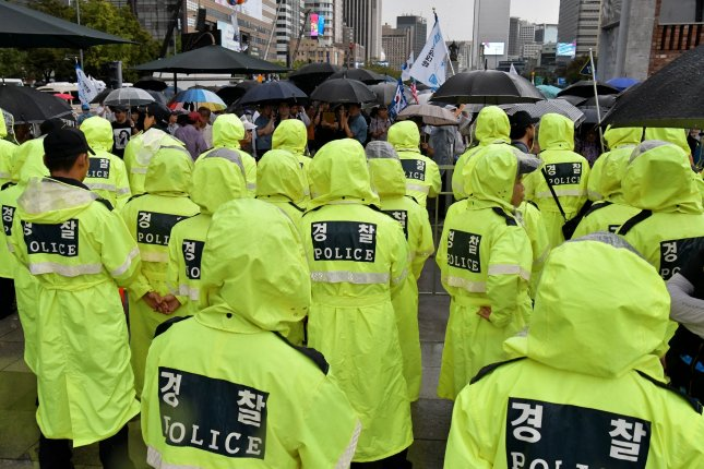 South Korea police clashed with North Korean defectors in Seoul on Tuesday amid a dispute over a tent set up by the activists in protest of recent events. File Photo by Keizo Mori/UPI