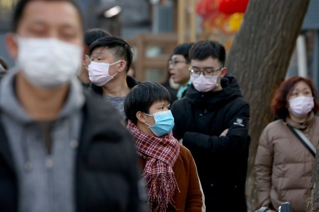 People in Beijing wear protective respiratory masks as the coronavirus outbreak has grown in China and spread to other parts of the world. Photo by Stephen Shaver/UP