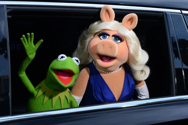 Kermit the Frog (L) and Miss Piggy attend the premiere of Muppets Most Wanted in Los Angeles in 2014. Kermit got the boot from The Masked Singer Wednesday night. File Photo by Jim Ruymen/UPI
