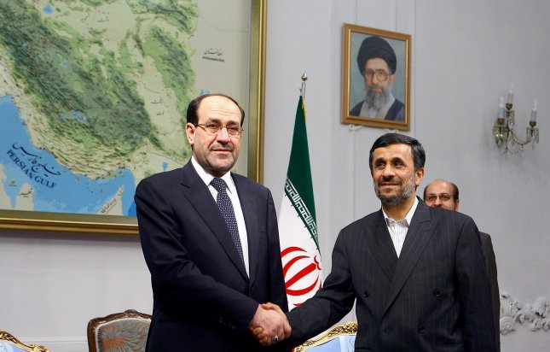 Iraqi Prime Minister Nuri al-Maliki (L) shakes hands with Iranian President Mahmoud Ahmadinejad (R) in the Presidential Palace in Tehran, Iran on Oct.18, 2010. UPI/Maryam Rahmanian