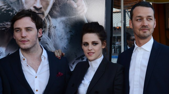 Director Rupert Sanders (R) attends a screening of his new motion picture fantasy Snow White and the Huntsman, with cast members Sam Caflin (L) and Kristen Stewart (C), at the Village Theatre in the Westwood section of Los Angeles on May 29, 2012. UPI/Jim Ruymen