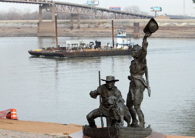 A barge heads for shore in front of the Lewis and Clark statue on the Mississippi River in St. Louis Dec. 7, 2012. UPI/Bill Greenblatt