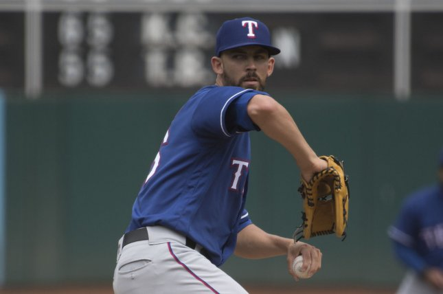 Texas Rangers pitcher Mike Minor throws to the Oakland A's in the first inning on August 22, 2018 at the Coliseum in Oakland, California. Photo by Terry Schmitt/UPI