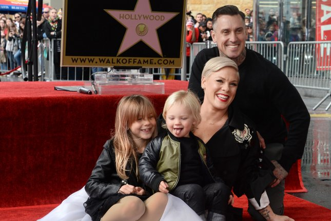 Pink, pictured with Carey Hart, daughter Willow and son Jameson, explained how her kids have made her a more open and accepting person. File Photo by Jim Ruymen/UPI