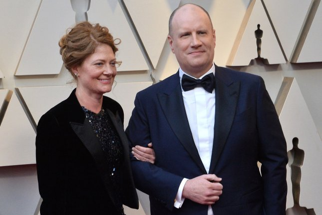 Marvel Studios head Kevin Feige (R) and Caitlin Feige arrive on the red carpet for the 91st annual Academy Awards on February 2019. Kevin Feige's Star Wars film will be penned by Loki writer and executive producer Michael Waldron. File Photo by Jim Ruymen/UPI