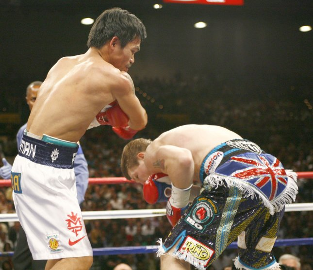 Manny Pacquiao attacks Ricky Hatton on May 2, 2009. (UPI Photo/Roger Williams)