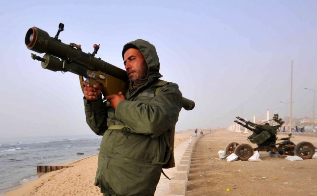A Libyan opposition forces fighter manages a mobile anti-aircraft gun in the city of Ajdabiya,160kms west of Benghazi, Libya on March 2, 2011. Gadhafi warned the West against intervening in the rebellion against his rule. UPI/Mohamaad Hosam