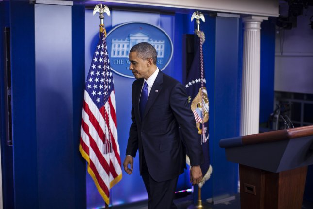 U.S. President Barack Obama leaves the podium after making a statement about the fiscal cliff negotiations at the White House in Washington, Dec. 21, 2012. UPI/Jim Lo Scalzo/pool