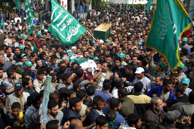 Palestinians carry the body of Abdel Aziz Rantisi, Hamas leader, in a funeral procession in Gaza City April 18, 2004. (UPI/Ismael Mohamad)