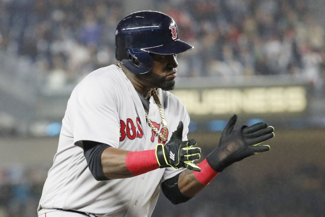 Former Boston Red Sox DH David Ortiz reacts on third base after Mookie Betts drives in 2 runs with a double in the 8th inning against the New York Yankees at Yankee Stadium in New York City on September 28, 2016. Photo by John Angelillo/UPI