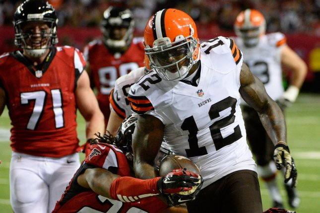 Former Cleveland Browns wide receiver Josh Gordon (12) runs for extra yardage against the Atlanta Falcons during the first half on November 23, 2014 at the Georgia Dome in Atlanta. File photo by David Tulis/UPI