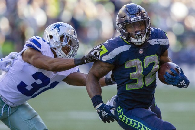 Seattle Seahawks running back Chris Carson (32) rushes for a 13-yard gain against Dallas Cowboys defensive back Byron Jones (31) during the third quarter on Sunday at CenturyLink Field in Seattle, Washington. Photo by Jim Bryant/UPI