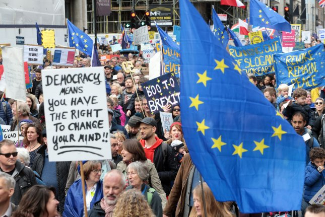 Activists rally in London on March 23 at a demonstration calling for a second referendum on whether to leave or remain part of the European Union. File Photo by Hugo Philpott/UPI