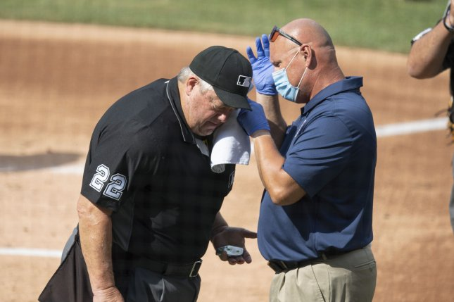 MLB home plate umpire Joe West is looked at by medical personnel after he was hit by a bat during the first inning of Thursday's game between the Washington Nationals and Toronto Blue Jays at Nationals Park in Washington, D.C. Photo by Pat Benic/UPI