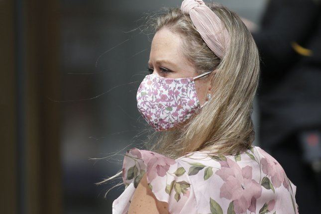 A masked woman is seen in New York City on Monday during a grand opening ceremony at the One Vanderbilt Skyscraper. The tower is Manhattan's newest, skyline-defining tower. Photo by John Angelillo/UPI