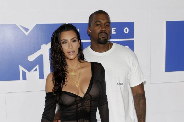Kim Kardashian West and Kanye West arrive on the red carpet at the 2016 MTV Video Music Awards at Madison Square Garden in New York City on August 28, 2016. West gave a speech onstage Sunday where he referenced Taylor Swift and other celebrities before introducing his new music video for Fade. File Photo by John Angelillo/UPI