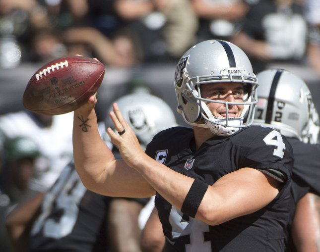 Derek Carr and the Oakland Raiders take on the Denver Broncos in a key early-season matchup of AFC West rivals. Photo by Terry Schmitt/UPI