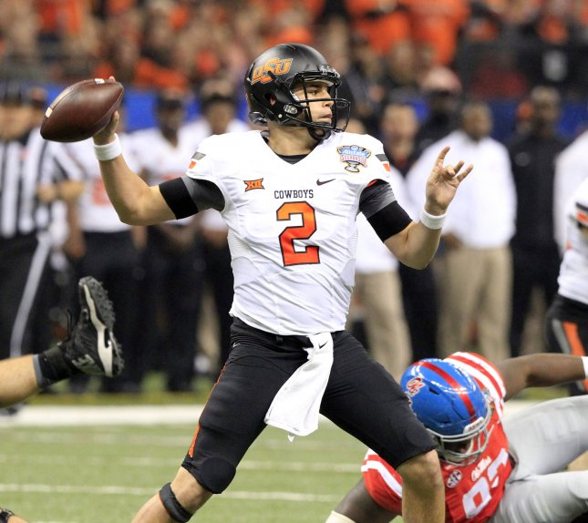 Mason Rudolph and Oklahoma State survived a scare from Texas on Saturday. Photo by A.J. Sisco/UPI