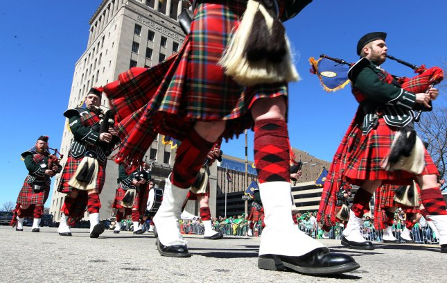 A bagpipe band marches down Market Street during the St. Louis St. Patrick's Day Parade in St. Louis on March 15, 2014. In New Zealand, a man was pulled over for playing bagpipes while driving. File Photo by Bill Greenblatt/UPI