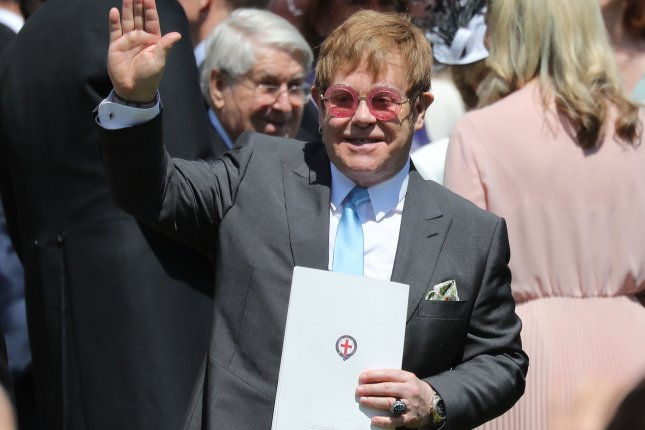 Musician Elton John waves to the crowd as he leaves St. George's Chapel in Windsor Castle after the royal wedding ceremony of Prince Harry and Meghan Markle on Saturday. Photo by Hugo Philpott/UPI