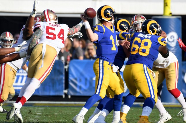 San Francisco 49ers defensive end Cassius Marsh (54) knocks the ball out of Los Angeles Rams quarterback Sean Mannion's hand on December 31, 2017 in Los Angeles. Photo by Jon SooHoo/UPI