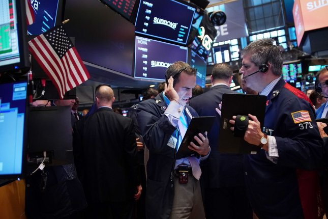 Traders work on the the floor of the New York Stock Exchange July 25 on Wall Street in New York City. Photo by John Angelillo/UPI