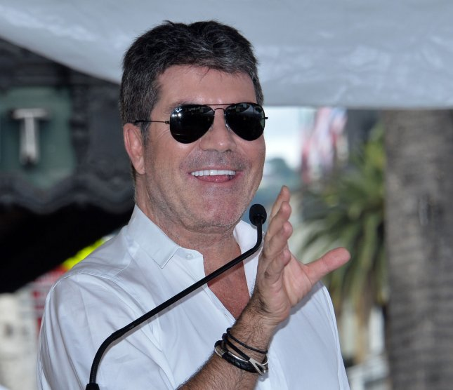 Simon Cowell was hospitalized Saturday after injuring his back in a bicycle riding accident. File Photo by Jim Ruymen/UPI