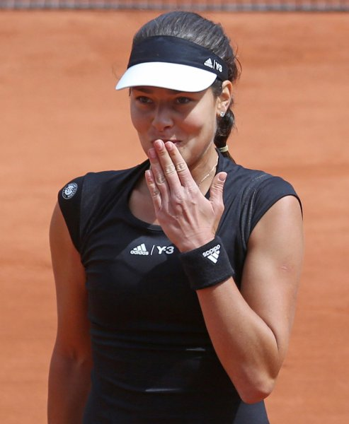 Ana Ivanovic of Serbia blows a kiss after winning her French Open women's third round match against Donna Vekic of Croatia at Roland Garros in Paris on May 29, 2015. Ivanovic defeated Vekic 6-0, 6-3 to advance to the next round. Photo by David Silpa/UPI
