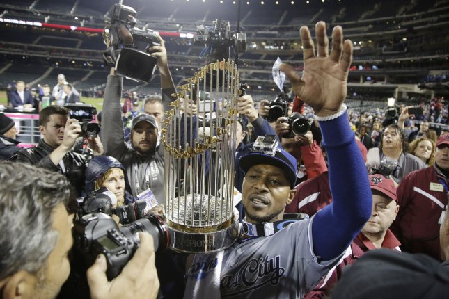 15c2b3de5 Kansas City Royals Jarrod Dyson holds Major League Baseball s championship  trophy when he celebrates with teammates on the field after the Royals win  the ...