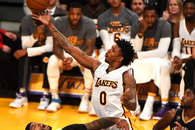 Los Angeles Lakers guard Nick Young (R) shoots over Pelicans center DeMarcus Cousins (L) at Staples Center in Los Angeles, March 5, 2017. File photo by Jon SooHoo/UPI