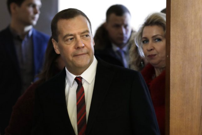 Russian Prime Minister Dmitry Medvedev signs an interim agreement that sets up a free-trade agreement with Iran. Both countries are facing increased U.S. economic pressures. Photo by Yuri Gripas/UPI