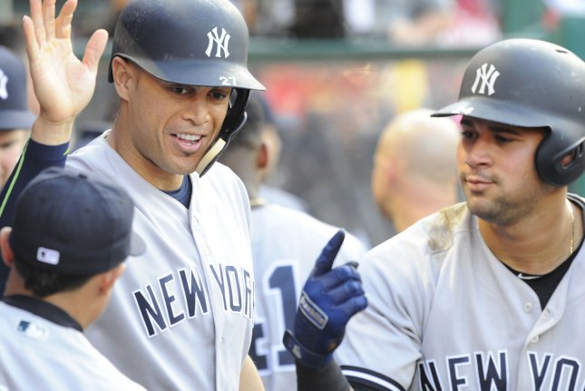 New York Yankees' Gary Sanchez, right, and Giancarlo Stanton celebrate. Photo by Lori Shepler/UPI