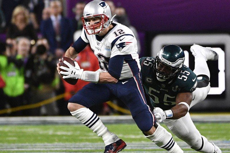Philadelphia Eagles defensive end Brandon Graham (55) stops New England Patriots quarterback Tom Brady (12) during the fourth quarter of Super Bowl LII on February 4 at U.S. Bank Stadium in Minneapolis. Photo by Brian Kersey/UPI