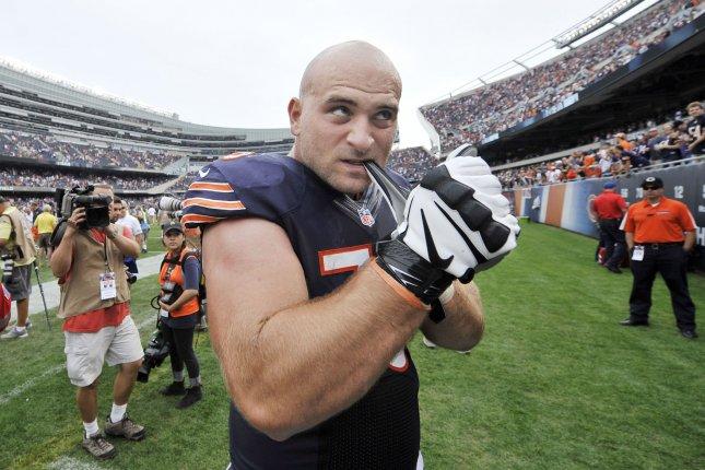 Chicago Bears offensive guard Kyle Long pulls off his gloves to give to fans after a game against the Cincinnati Bengals on September 8, 2013 at Soldier Field in Chicago. File photo by Brian Kersey/UPI