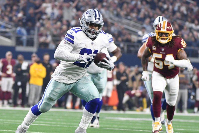 Dallas Cowboys running back Ezekiel Elliott (21) scores on a 16-yard run against the Washington Redskins on November 22, 2018 at AT&T Stadium in Arlington, Texas. Photo by Ian Halperin/UPI