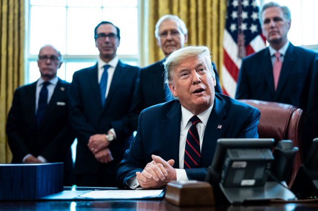 President Donald Trump participates in a signing ceremony for a $2.2 trillion coronavirus relief bill in the Oval Office on March 27. Treasury Secretary Steven Mnuchin (2nd-L) was ordered to halt dispersal of funds to tribal governments amid a court battle over whether Native corporations should be eligible to receive the aid. Photo by Erin Schaff/UPI