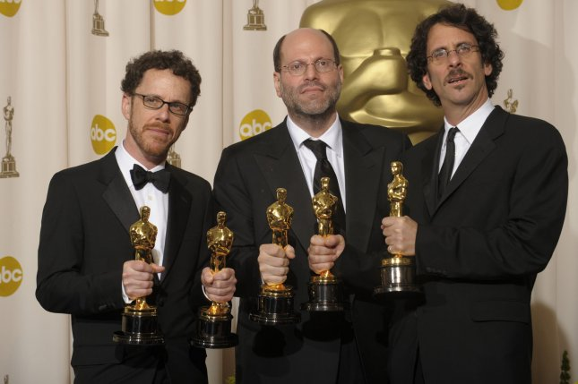 Producers Ethan Coen (L,) Scott Rudin (C) and Joel Coen (R) pose with their Oscars after their film No Country for Old Men won Best Picture at the 80th Academy Awards in Hollywood in 2008. File Photo by Phil McCarten/UPI