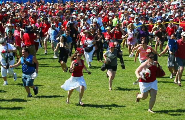 Thousands of Canadians dash across the west lawn hoping to greet Their Royal Highnesses Prince William and Catherine, The Duke and Duchess of Cambridge during Canada Day celebrations on Parliament Hill in Ottawa on July 1, 2011. An estimated crowd of 300,000 spectators squeezed onto the Hill for the noon day show. (UPI Photo/Grace Chiu)