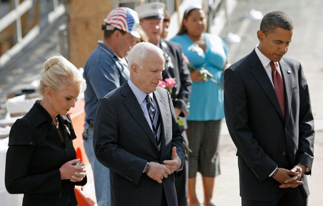 Democratic presidential candidate Senator Barack Obama (D-IL) (R), Republican presidential candidate Sen. John McCain (R-AZ) (C) and his wife Cindy McCain pause for a moment of silence at the site of the former twin towers, on the seventh anniversary of the attack on the World Trade Center, in New York September 11, 2008. (UPI Photo/Peter Foley/POOL)