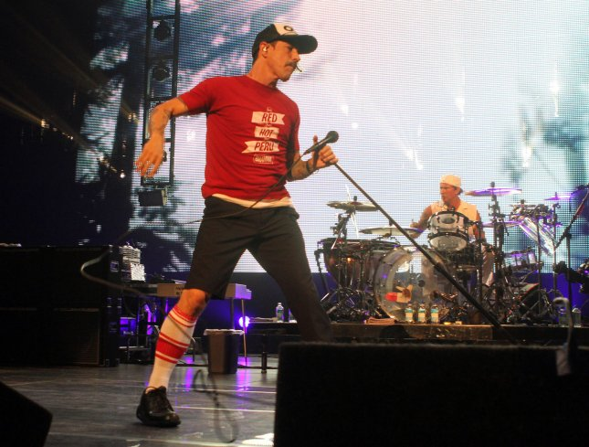 Anthony Kiedis and Chad Smith (R) perform with the Red Hot Chili Peppers in concert, at the BankAtlantic Center in Sunrise, Florida on April 2, 2012. UPI/Michael Bush