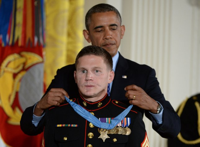 U.S. President Barack Obama awards the Medal of Honor to retired Marine William Kyle Carpenter in the East Room of the White House June 19, 2014. Carpenter, 24, of Gilbert, S.C., received the nation's highest award for gallantry for covering a grenade with his body to save a fellow Marine in Afghanistan in 2010. UPI/Pat Benic