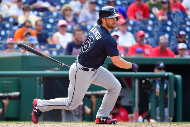 Atlanta Braves INF/OF Charlie Culberson autographed a baby's shirt before getting his first hit of spring training during a loss to the Houston Astros on Monday in Osceola County, Fla. Photo by Kevin Dietsch/UPI