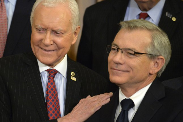 Arizona Rep. David Schweikert joins then-Utah Sen. Orrin Hatch to listen to a presentation of sweeping tax reform, on Capitol Hill in Washington, D.C., on September 27, 2017. File Photo by Mike Theiler/UPI
