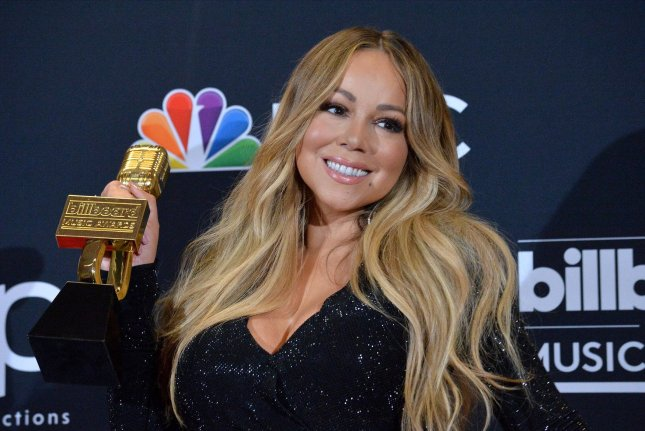 Mariah Carey appears backstage after winning the Icon award during the 2019 Billboard Music Awards at the MGM Grand Garden Arena in Las Vegas on May 1. The singer turns 50 on March 27. File Photo by Jim Ruymen/UPI