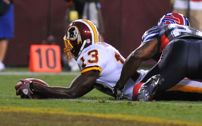 Washington Redskins' Anthony Armstrong (13) stretches for a touchdown against the against the Buffalo Bills' during the first quarter at FedEx Field in Washington on August 13, 2010. UPI/Kevin Dietsch